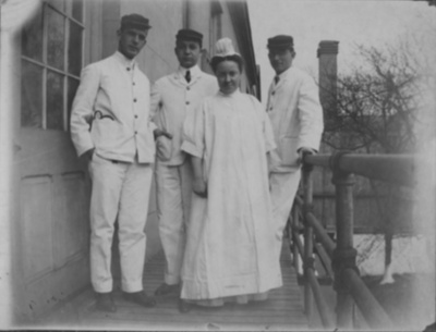 Physicians with nurse