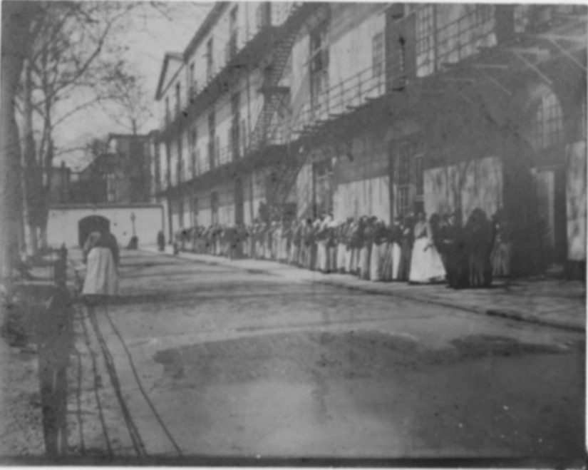Line of women standing outside of building