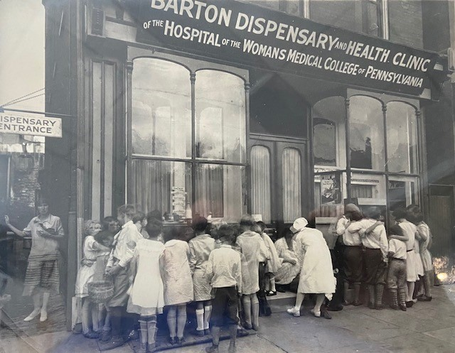 Children outside the Barton Dispensary and Health Clinic