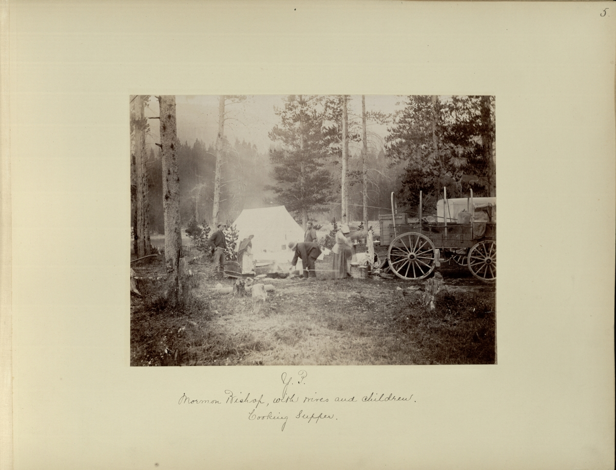 Y.P. : Mormon bishop, with wives and children, cooking supper