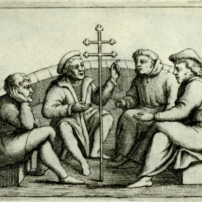 Four men in consultation