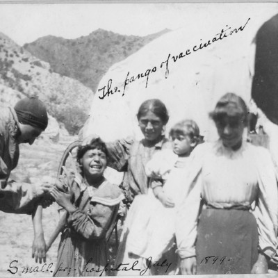 Photograph album from the Grape Creek Smallpox Camp and Hospital showing patients, staff, & vaccinations in 1898/1899