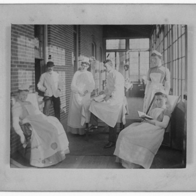Resident Physician and Nurses ca. 1890