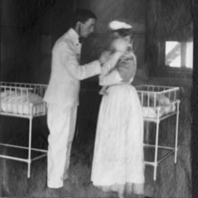 Physician examines infant