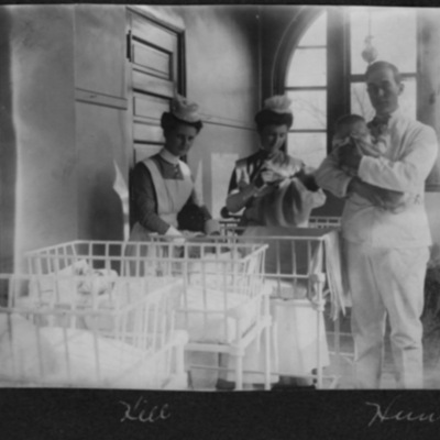 Physician and nurses attend infants